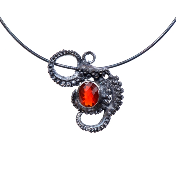 Silver tentacle necklace with briolette-cut red opal by Peggy Skemp 2010.