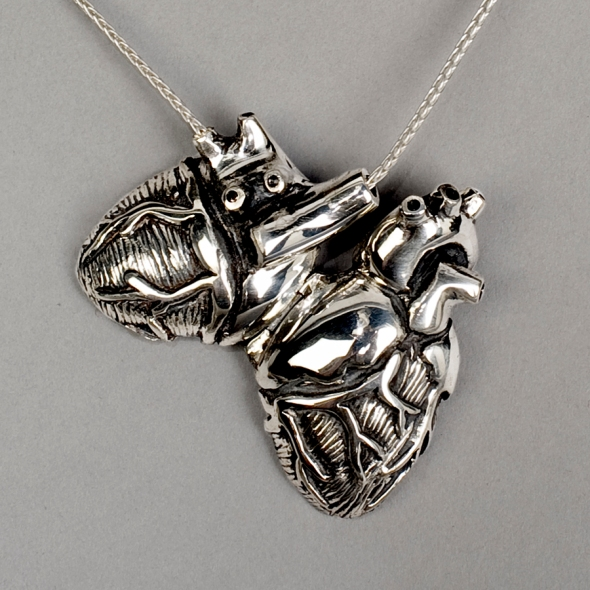 Original silver anatomical heart locket by Peggy Skemp