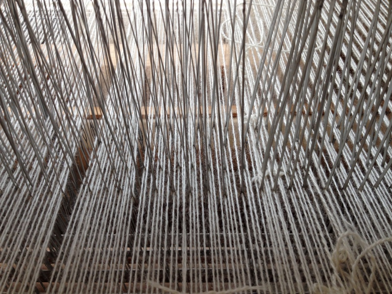 Heddles of my loom with wool spun by my grandmother.