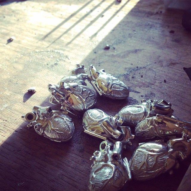 Silver original anatomical heart lockets in process.