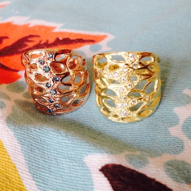 Rose gold with blue diamonds and 18k yellow gold with colorless diamond light in the branches rings.